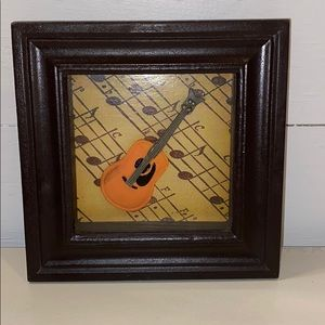 Vintage Shadow Box Frame With A Guitar.